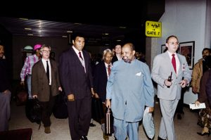 Former heavyweight World boxing champion Muhammad Ali (2nd L) is flanked by unidentified American hostages on December 02, 1990 at Amman International airport after their arrival from Baghdad. Ali was instrumental in the release of 15 US hostages held captive in Iraq.        (Photo credit should read RABIH MOGHRABI/AFP/Getty Images)